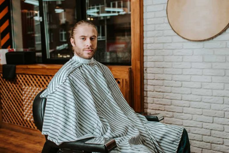 Man wearing a cool barber cape